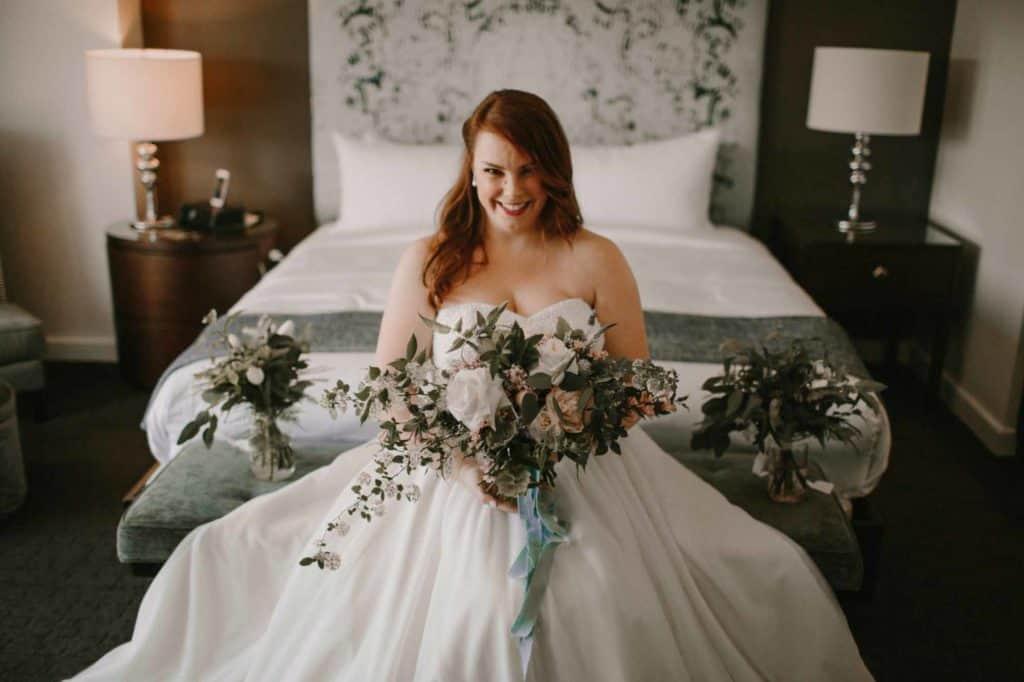 bride-posing-in-her-wedding-dress