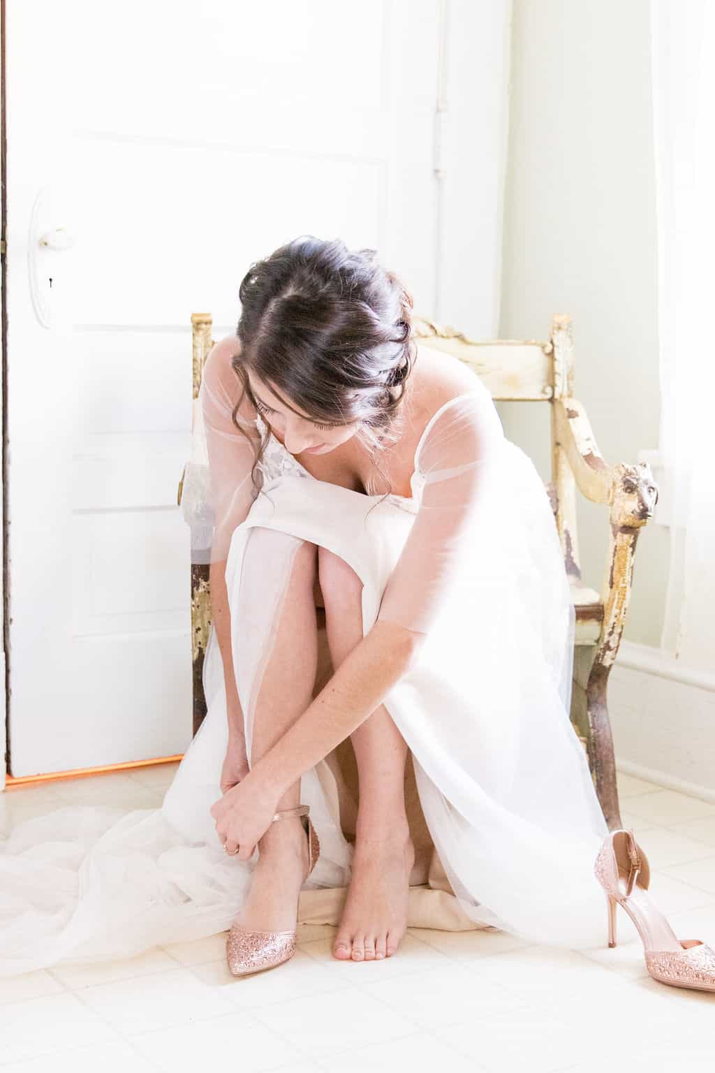 bride-puts-on-wedding-shoes-in-dressing-room-for-kansas-city-wedding