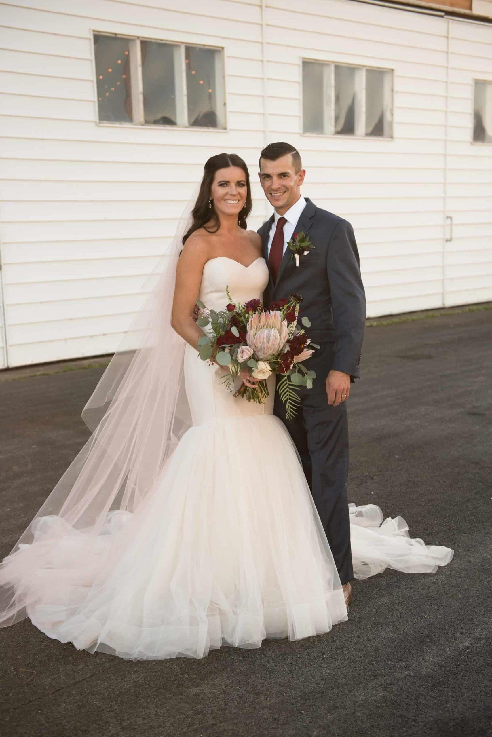 couple-smiling-postpone-wedding
